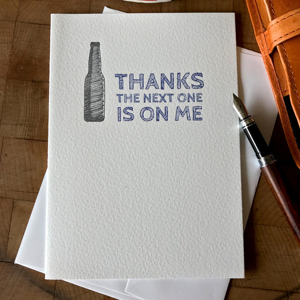 lifestyle image of thanks the next one is on me letterpress greeting card