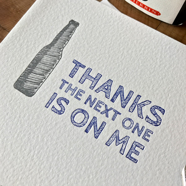 close up of thanks the next one is on me letterpress greeting card