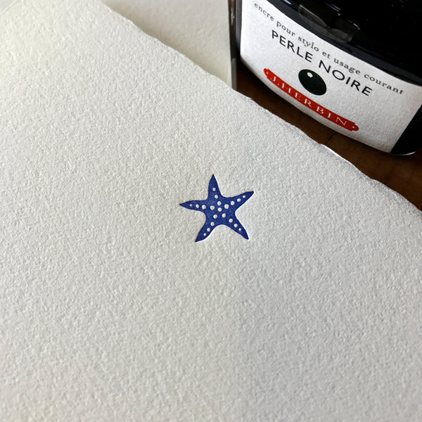 close up of starfish letterpress letter sheets
