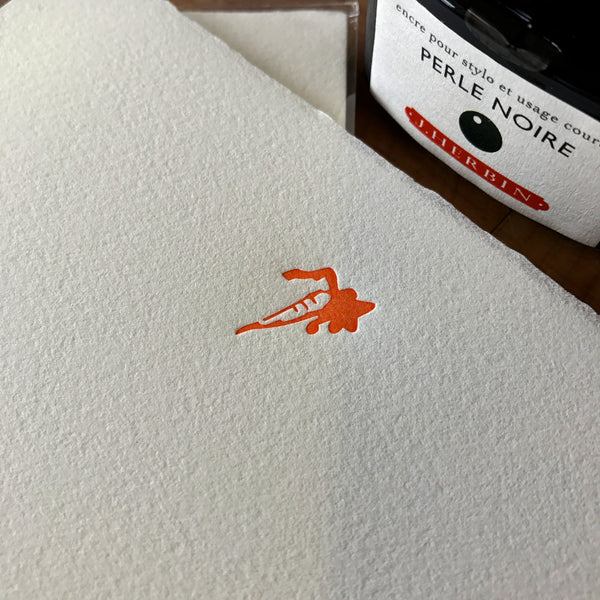 close up of carrot letterpress letter sheets