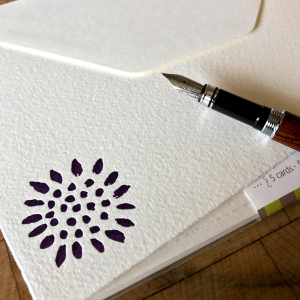 image of sunflower letterpress flat note in dark purple