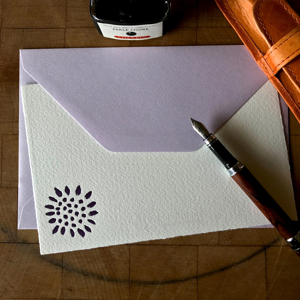 image of sunflower letterpress flat note with lavender envelope