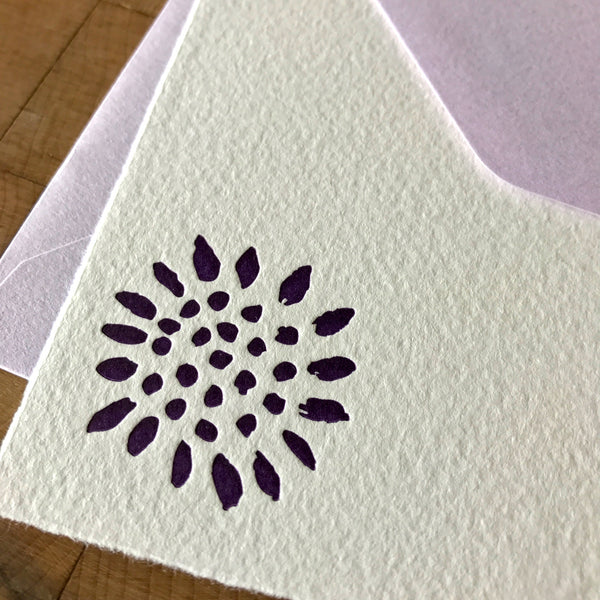 close up of sunflower letterpress flat note with lavender envelope