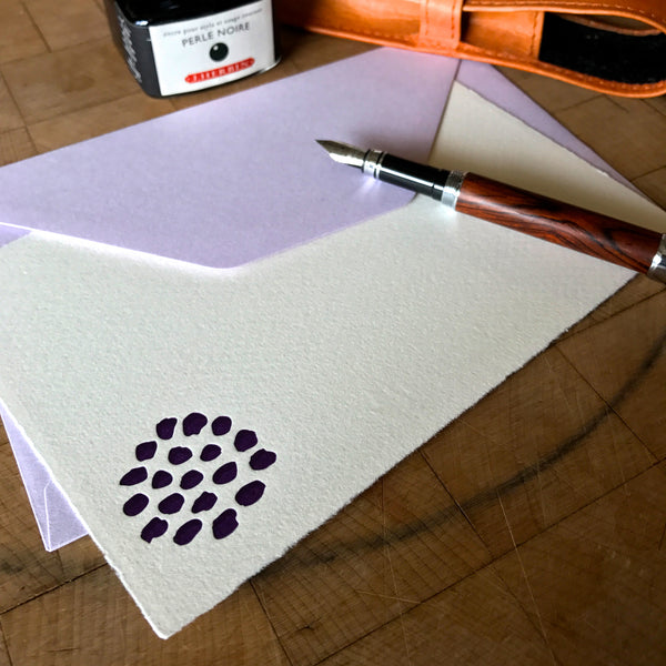 lifestyle image of bloom letterpress flat note with lavender envelope
