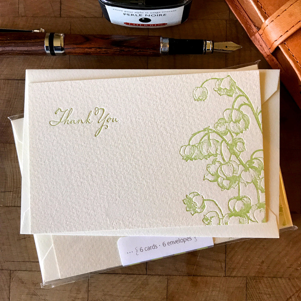 lifestyle image of lily of the valley thank you letterpress flat note