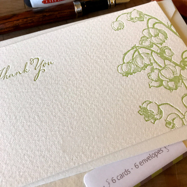 close up of lily of the valley thank you letterpress flat note