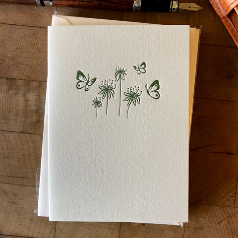 lifestyle image of butterflies and flowers letterpress folded card