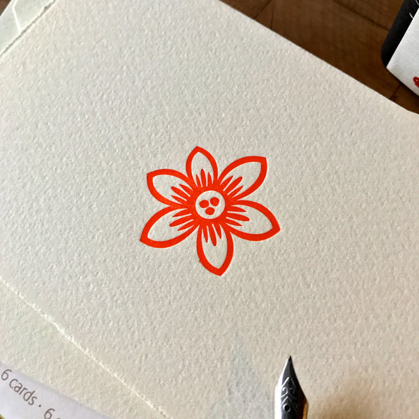 close up of pointed clematis letterpress folded note card