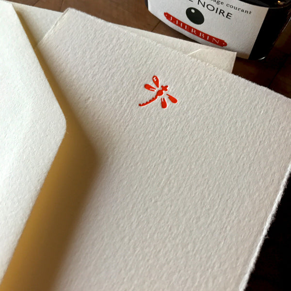 close up of dragonfly letterpress flat note card set in orange