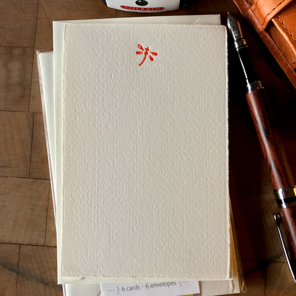 image of dragonfly letterpress flat note card set in orange