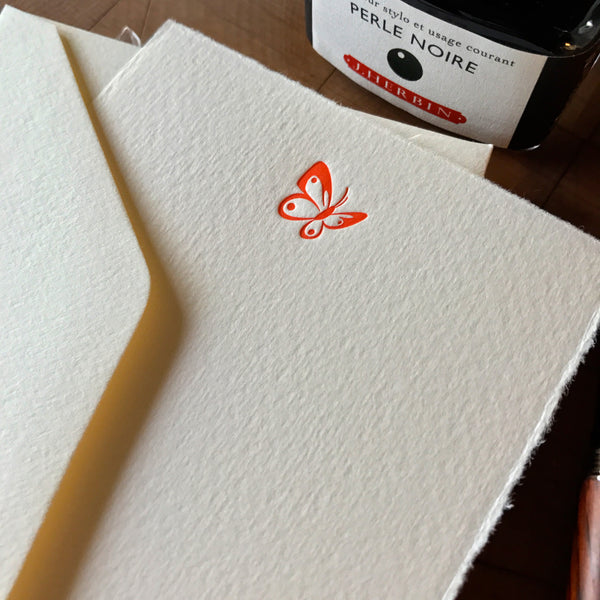 close up of butterfly letterpress flat note card in orange