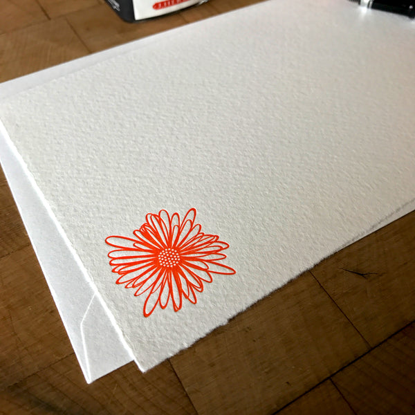 view of string flower letterpress flat note card in tigerlily