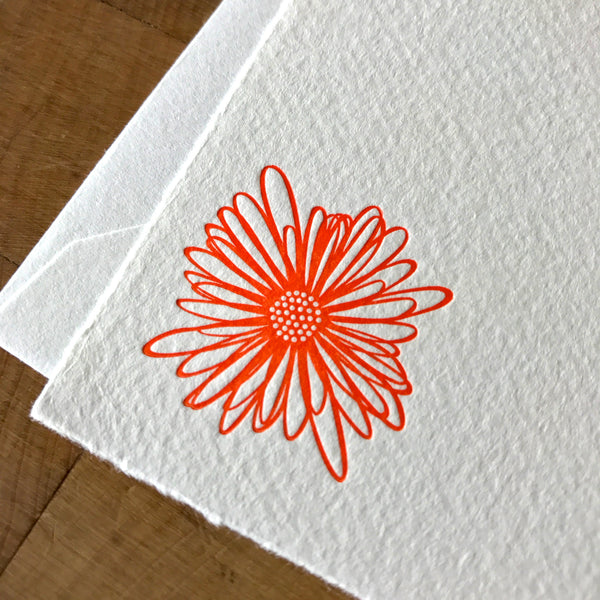 closeup of string flower letterpress flat note card in tigerlily