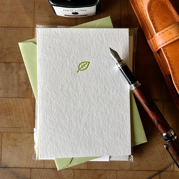 lifestyle image of leaf letterpress folder note card in dark chartreuse