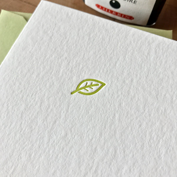 closeup of leaf letterpress folder note card in dark chartreuse