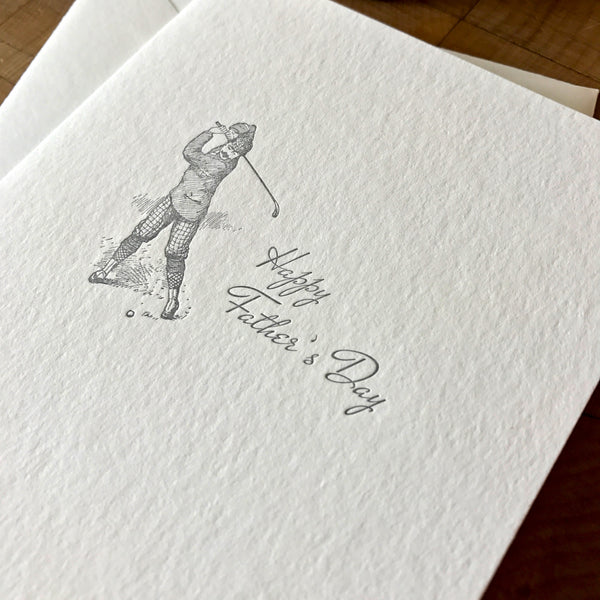 closeup of letterpress father's day card with old-time golfer