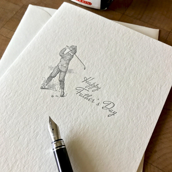 closeup of letterpress father's day card with old-time golfer with pen