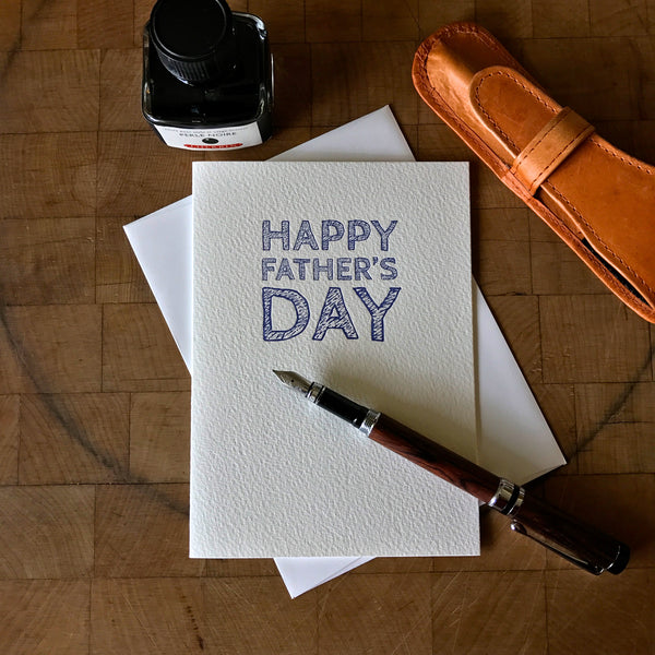 image of letterpress happy father's day greeting card with pen