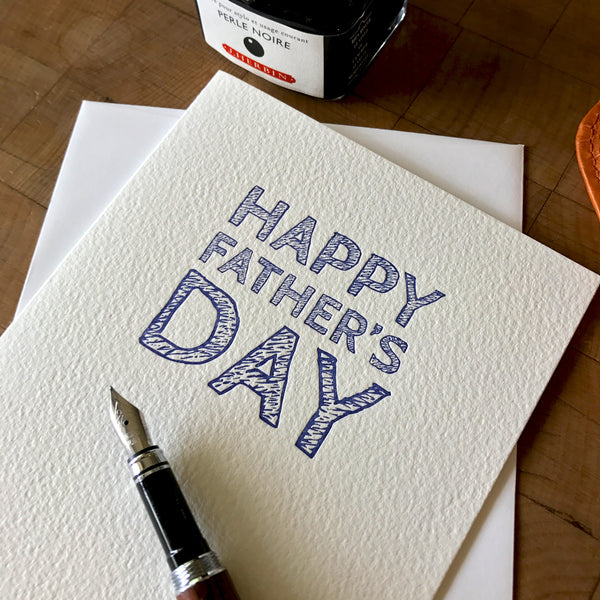 closeup of letterpress happy father's day greeting card