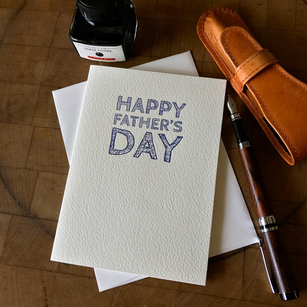 lifestyle image of letterpress happy father's day greeting card