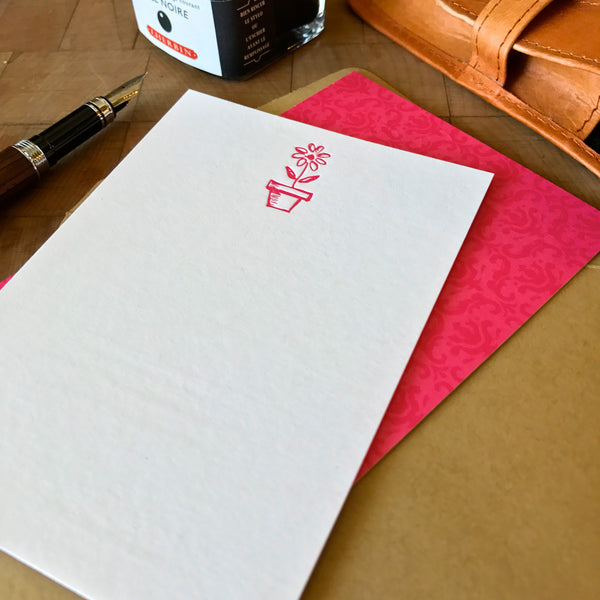image of flower in pot letterpress flat note printed in hot pink