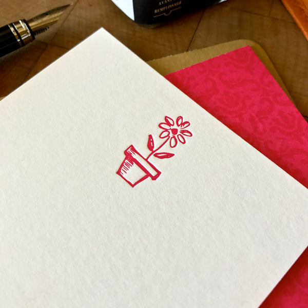 close up of flower in pot letterpress flat note printed in hot pink