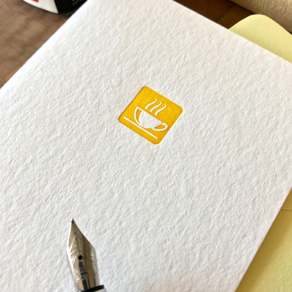 close up image of let's do coffee letterpress folded note card