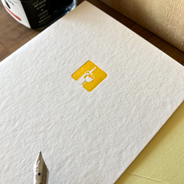 close up of chardonnay letterpress folded note card