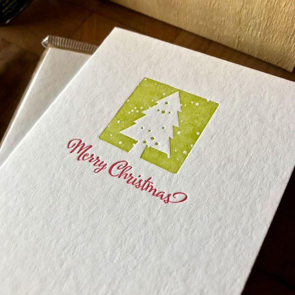 closeup of merry christmas letterpress card