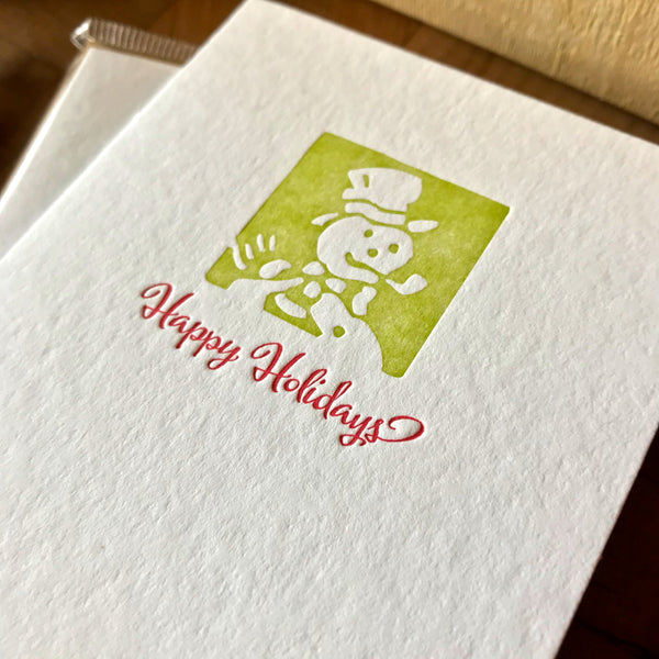 closeup of happy holidays letterpress card