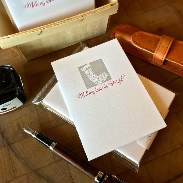 lifestyle image of making spirits bright letterpress holiday card