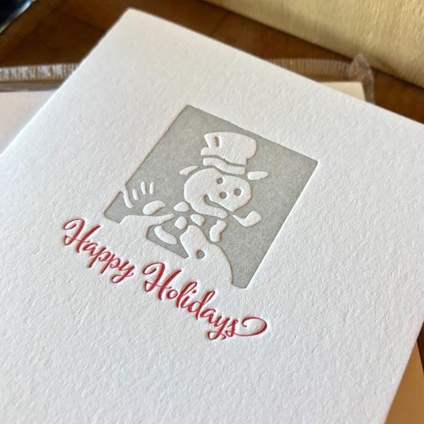 closeup of happy holidays letterpress holiday card
