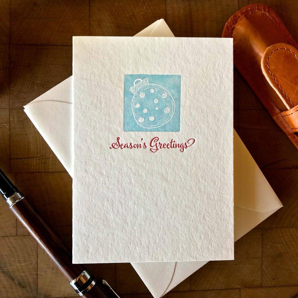 image of seasons greetings letterpress holiday card in red pepper and sky blue