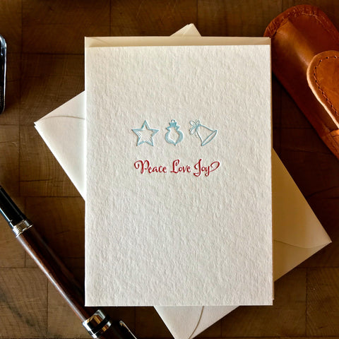 image of peace love joy letterpress holiday card in red pepper and sky blue