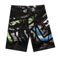 Men's Board Shorts - Black/Blue Palms | Action Pro Sports
