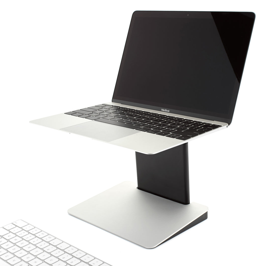 Tiny Tower Stand in Classic Silver at safe viewing height with Apple Macbook laptop and Apple Magic wireless keyboard.