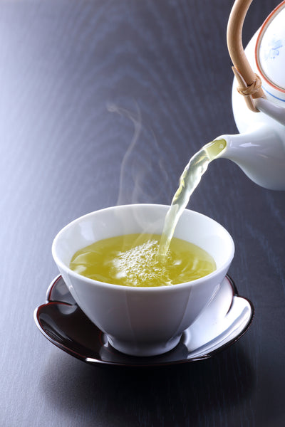 pouring Sencha tea