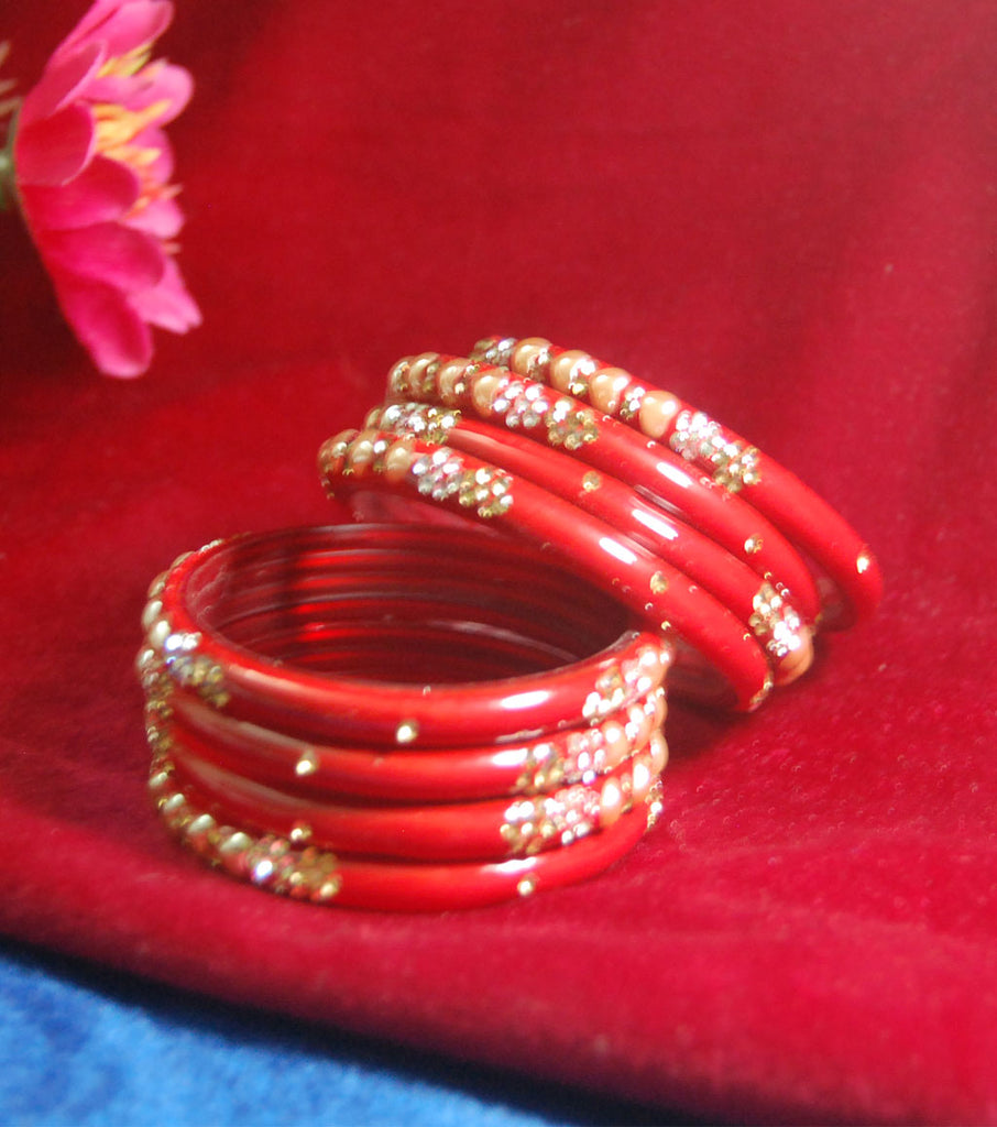 Red coloured fancy broad glass bangles