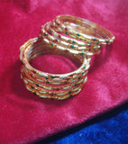Golden glass bangles with glitters