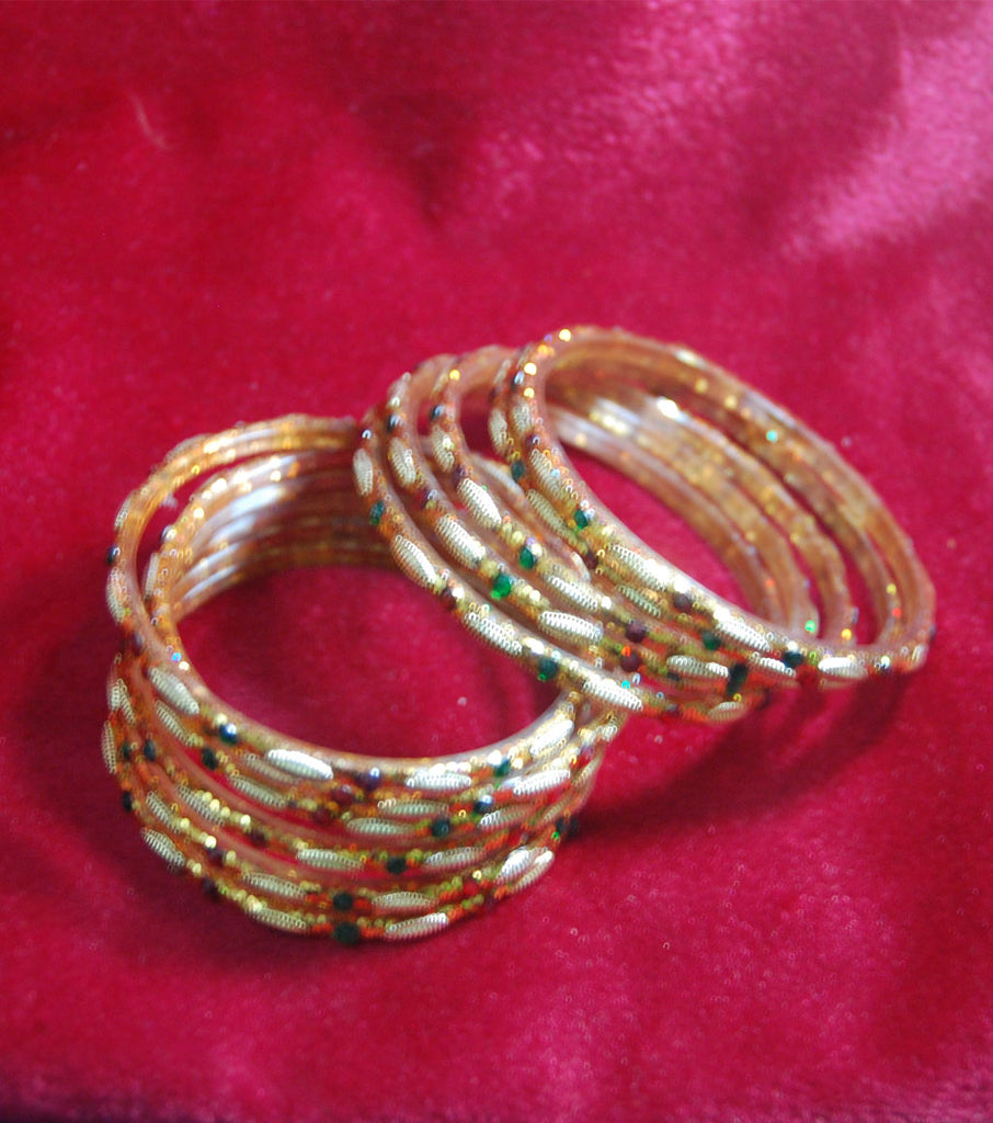 Golden glass bangles with glitters set of 16