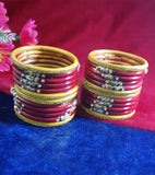 Red and yellow coloured lac bangle with beautiful design