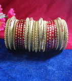 Maroon and golden coloured lac bangle having broad kangan with full work