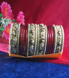 Maroon and golden coloured lac bangle beautifully designed with stones