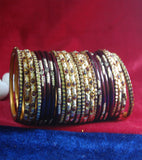 Maroon coloured lac bangle& golden kangan studded with stone