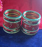 Red and green coloured lac bangle studded with nag set