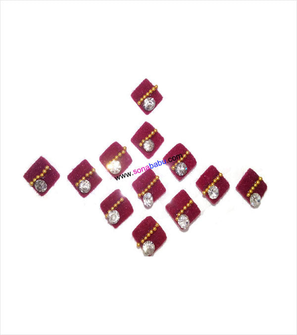 Kite shaped maroon bindis with stone