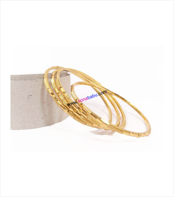 Gold toned bangles with cutting work set of 4