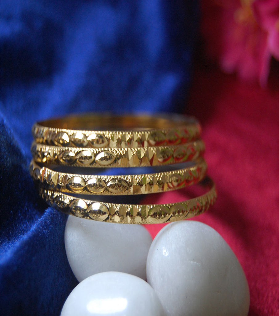 Gold plated bangles in churi style with cutting work set of 4