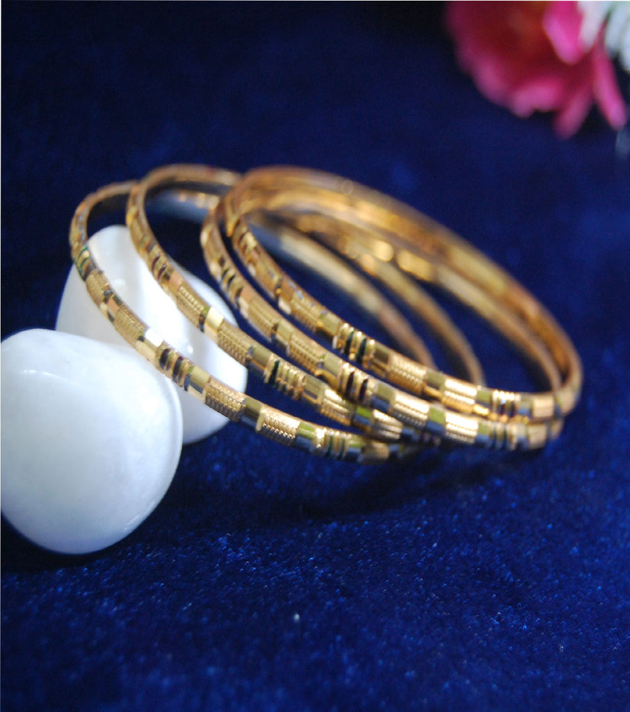 Gold plated bangles with work and lines set of 4