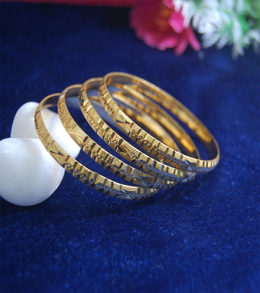 Gold plated bangles in cutting work set of 4